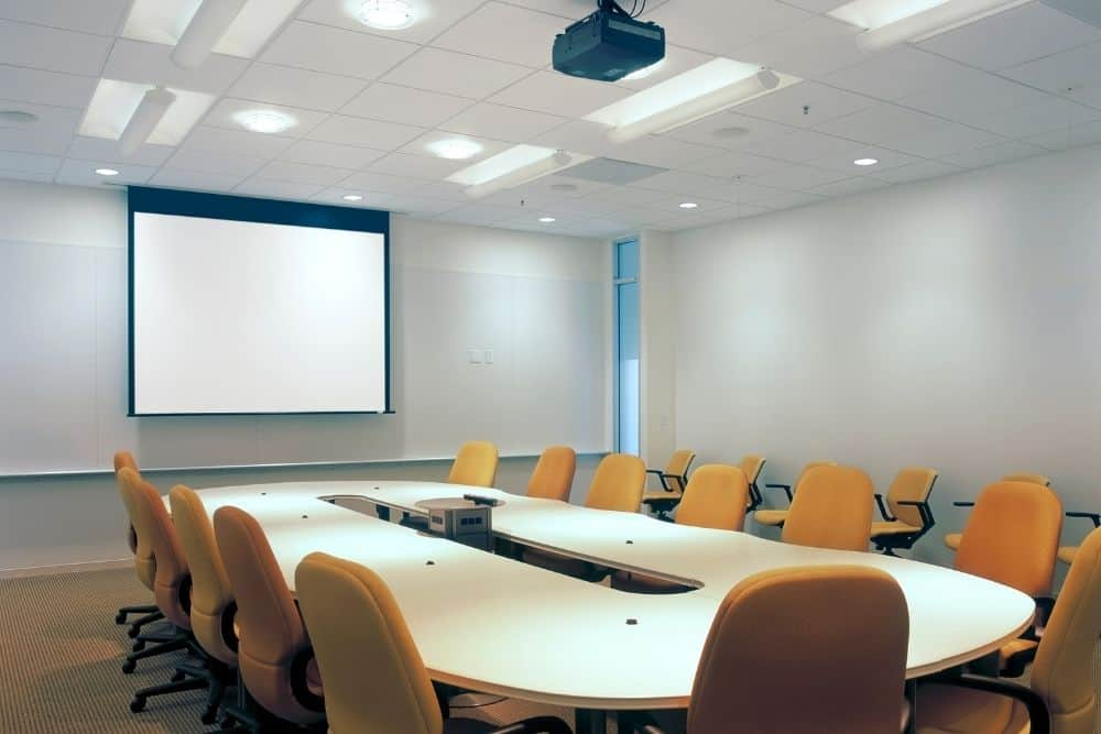 a rollable projector screen in an office