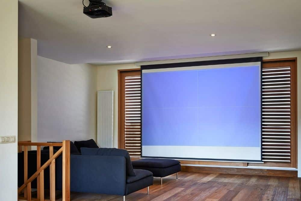 home theater with a white projector screen