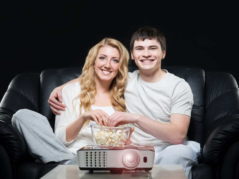 a couple with a movie projector
