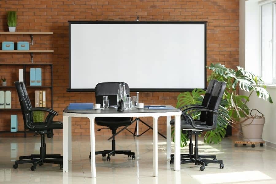 a white projector screen in an office
