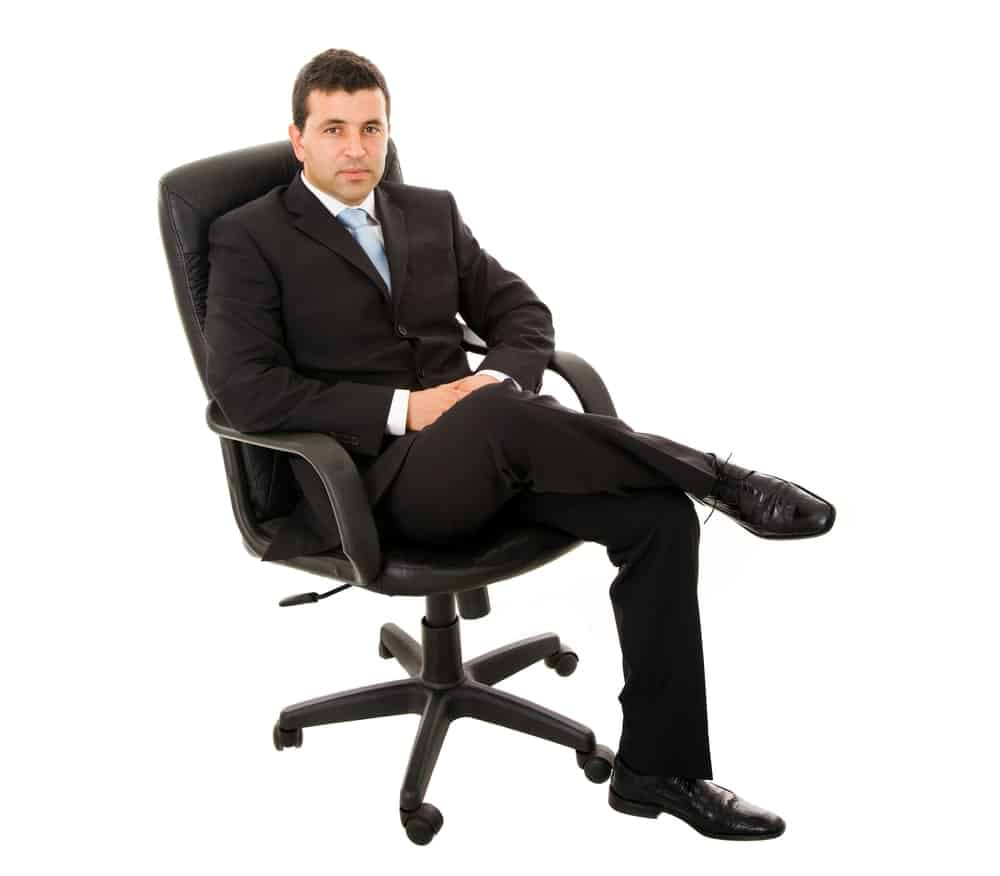 a businessman on an office chair