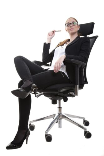 businesswoman sitting on a think padding office chair