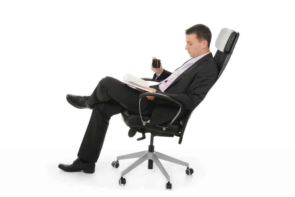 businessman on big tall office chair