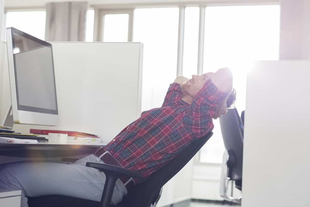 man relax on a reclining office chair