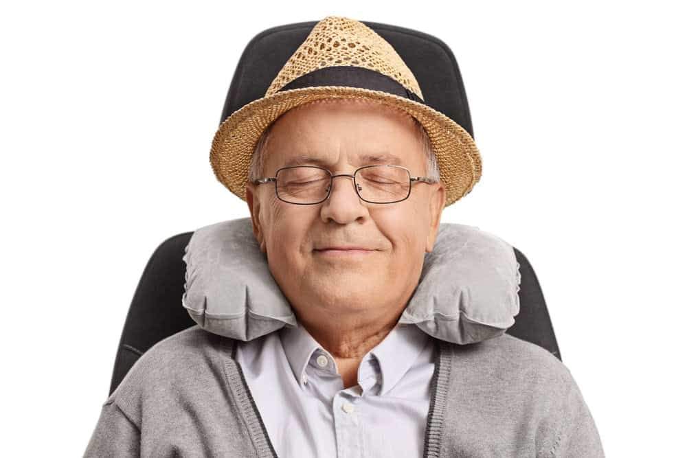 senior man relaxing with neck support