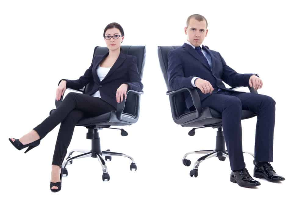 Young man and beautiful woman in business suits sitting in Herman Miller vs Steelcase Leap office chair