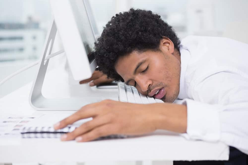 a man sleeping at desk