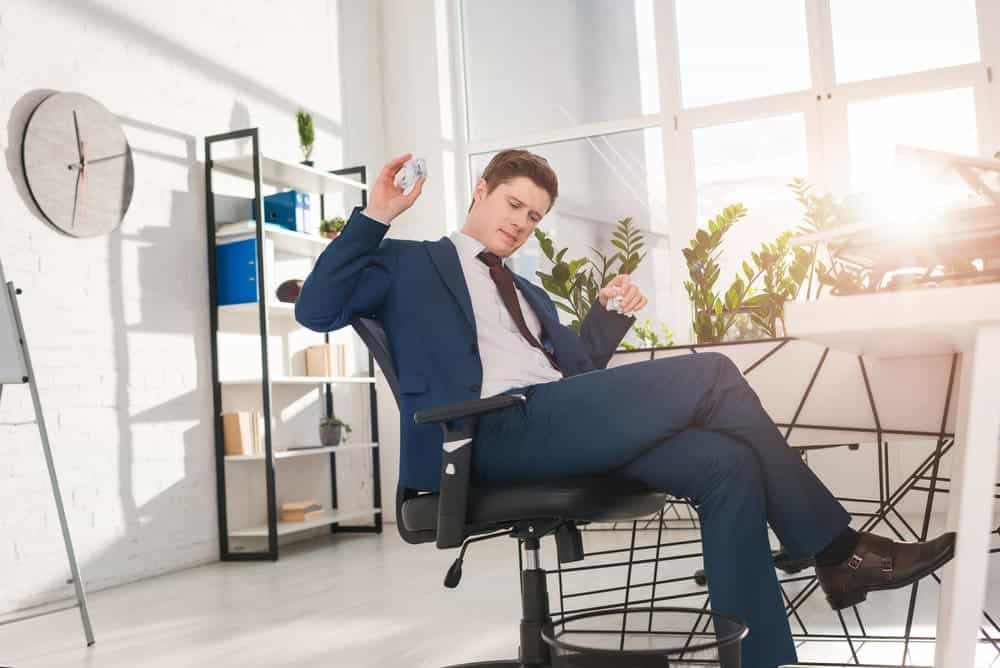businessman relax on Steelcase Leap office chair