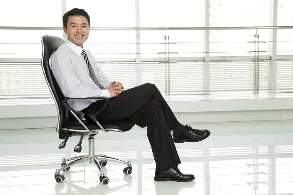 businessman sitting in standard office chair
