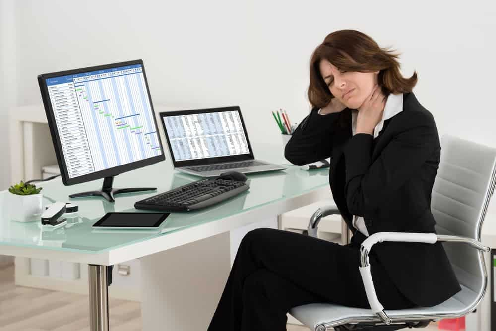 businesswoman on office chair having neck pain
