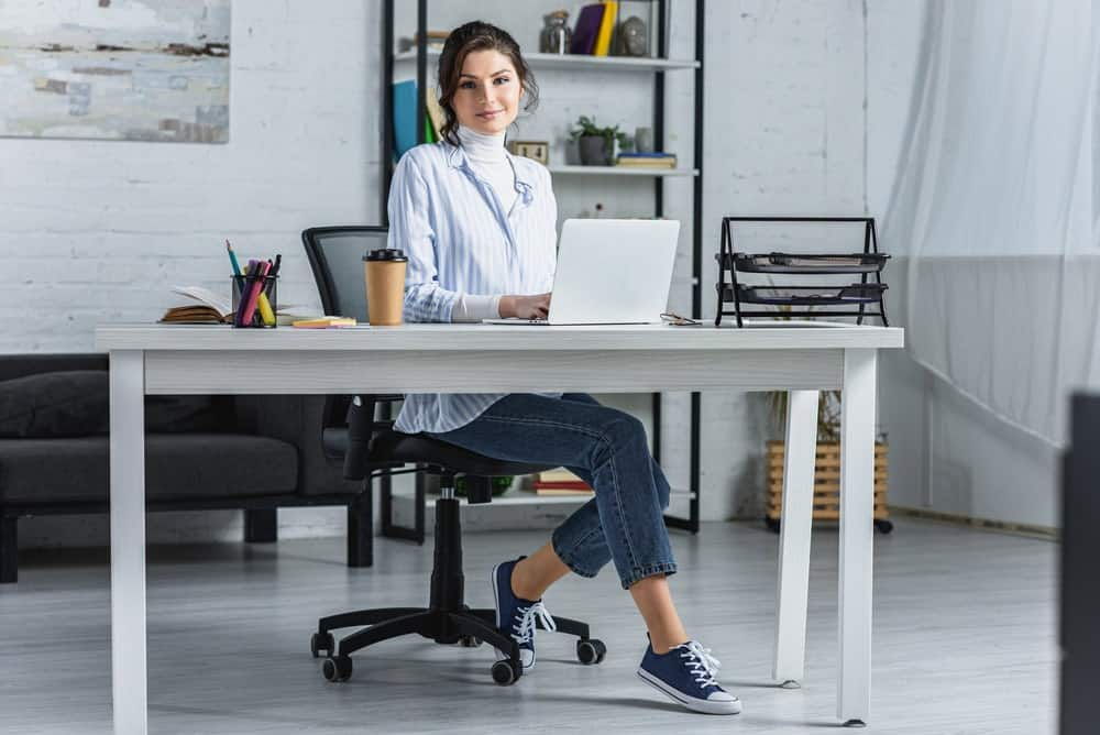 businesswoman sitting in Herman Miller office chair