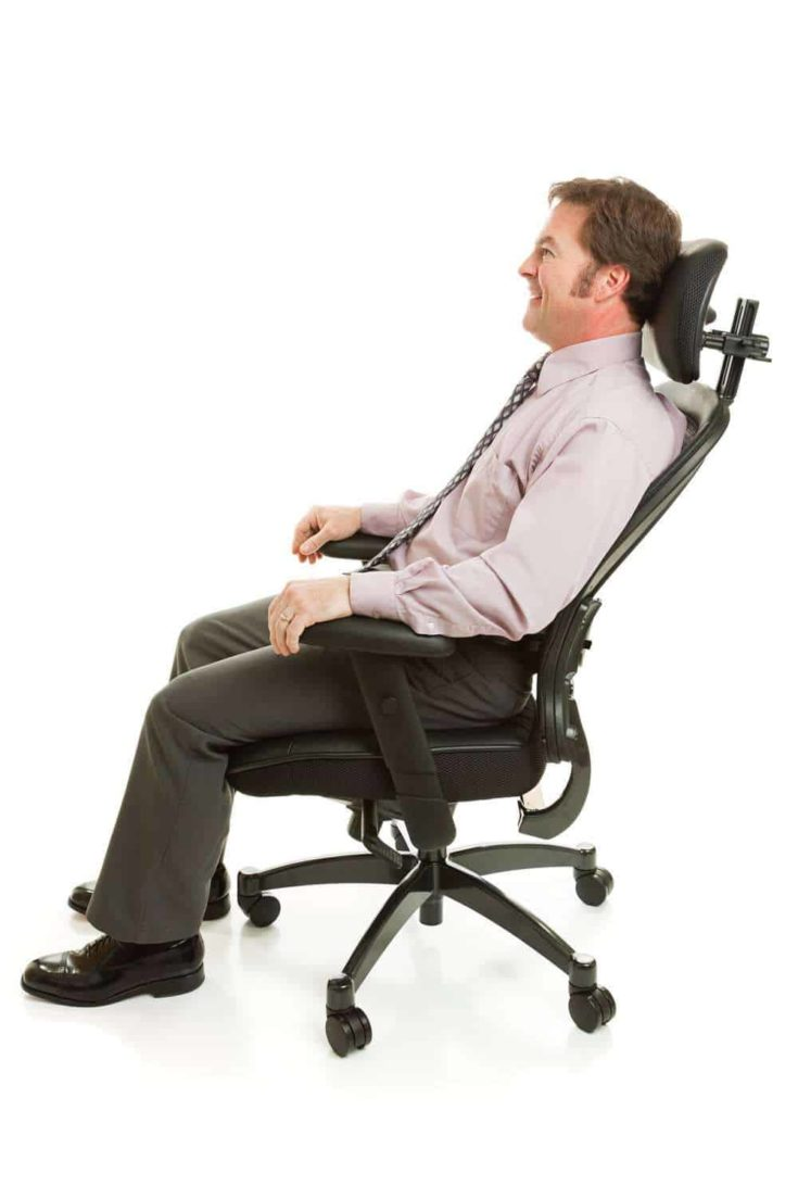 man relax on a headrest of ergonomic chair
