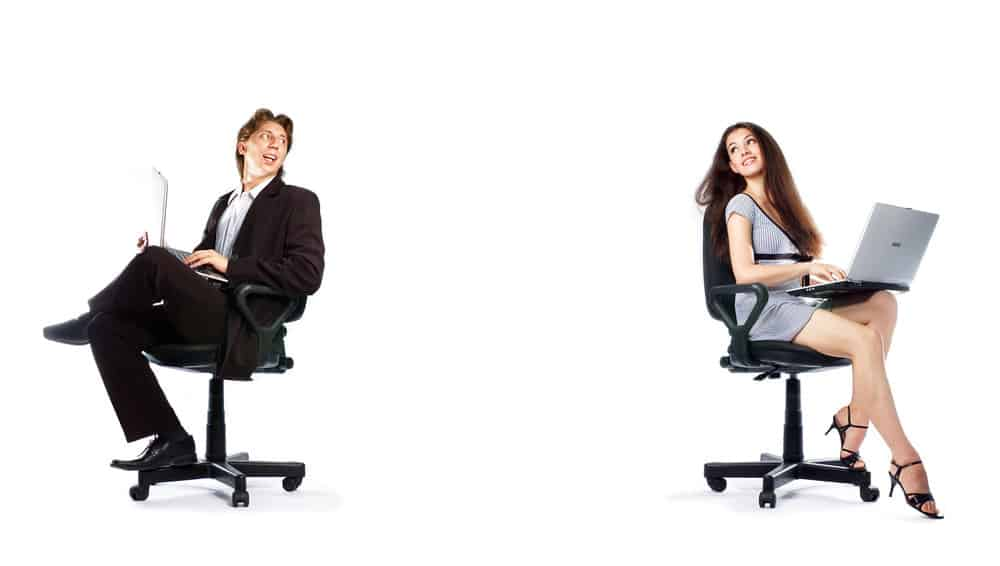 two people in Herman Miller and Steelcase office chairs