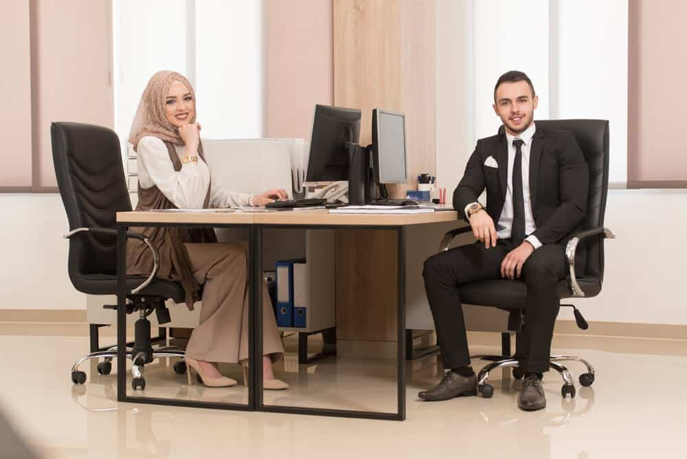 businessman and businesswoman on Steelcase Leap V2 and Steelcase Gesture office chairs