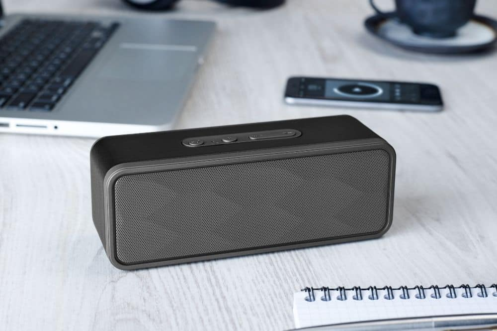 a portable speaker on the table