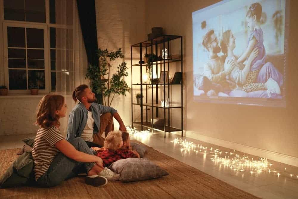 family using diy projector projecting images on the wall