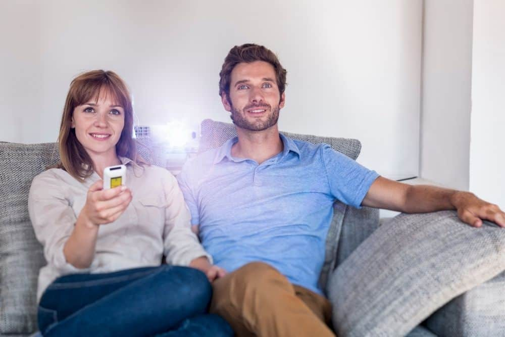 a couple watching movie with Epson 1040 Projector