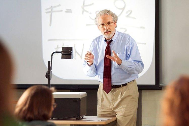 a teacher using an overhead projector in the classroom