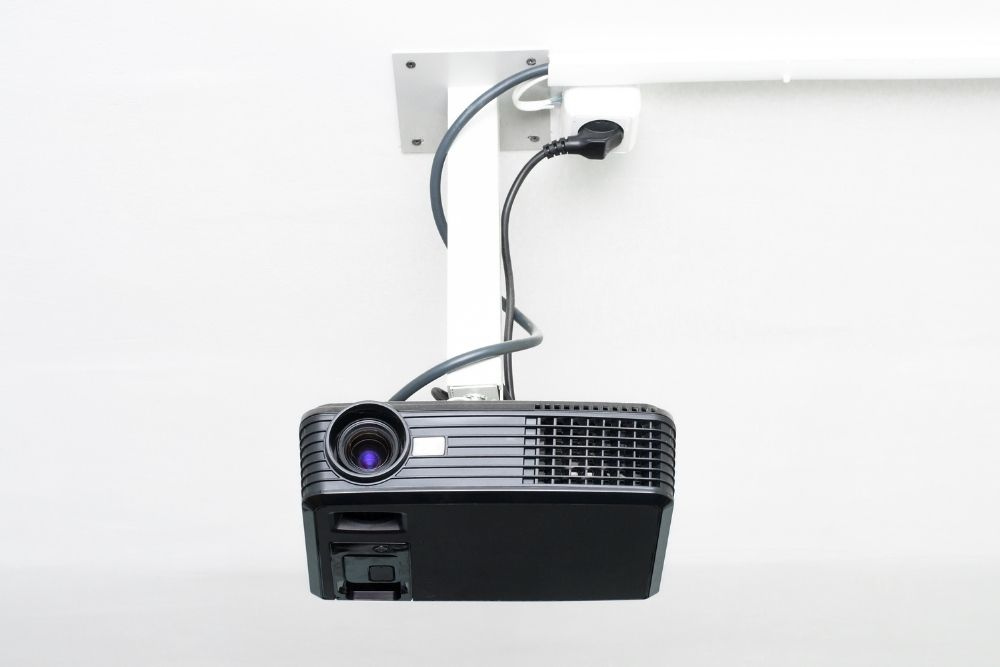 projector plugging into the socket on the ceiling