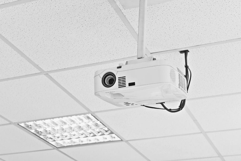 run power to a ceiling-mounted projector