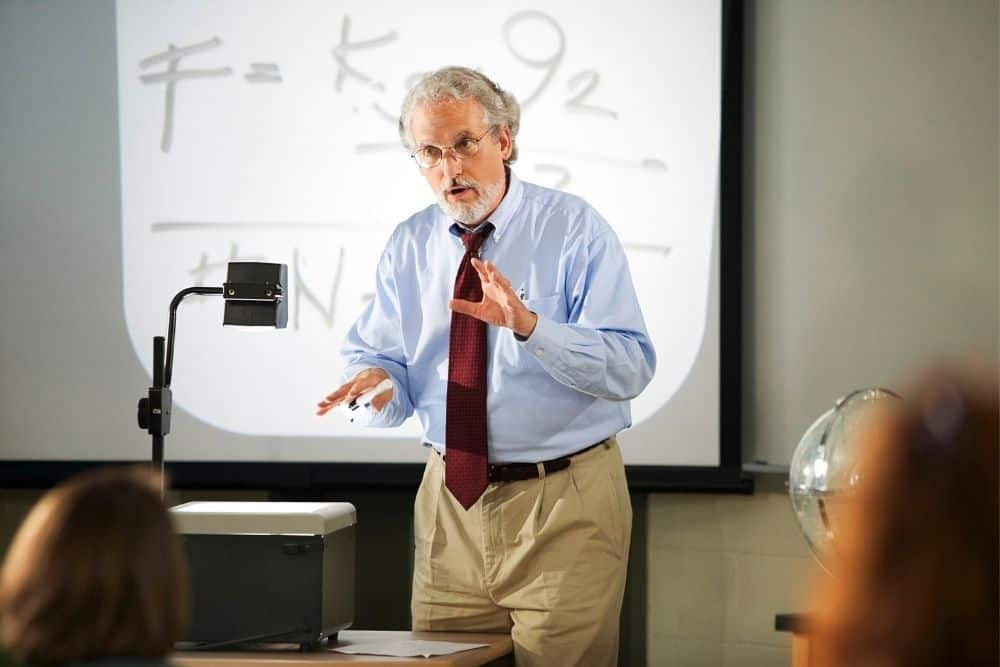 teacher using transparency films for overhead projector