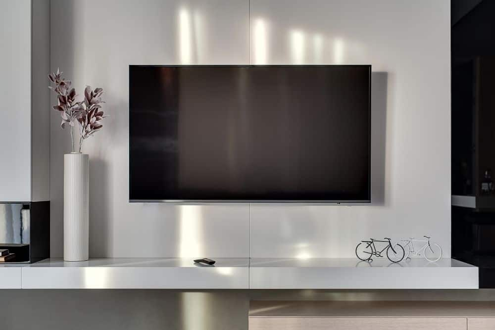the OLED TV hanging on the wall