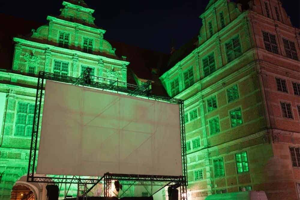 a large outdoor white projector screen tarp
