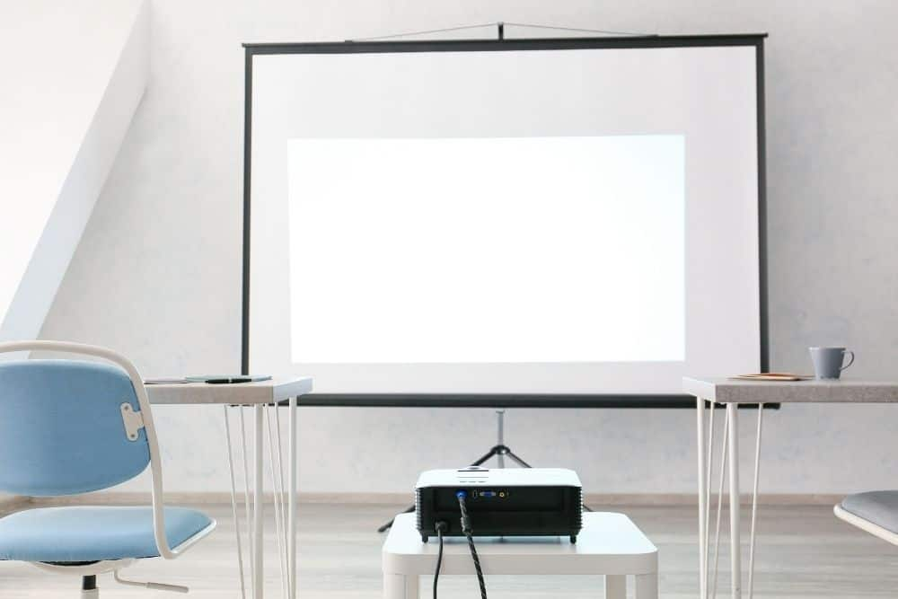 a short-throw projector on a small table
