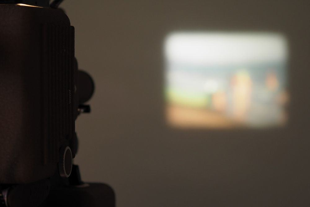 an opaque projector projecting images on the wall