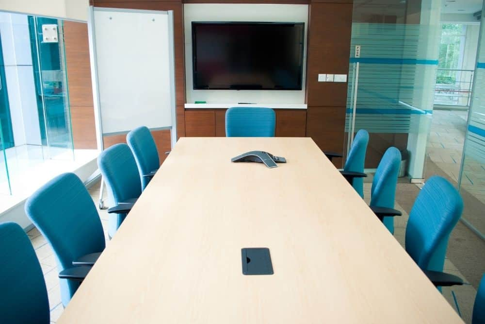 conference room with a TV screen on a wall