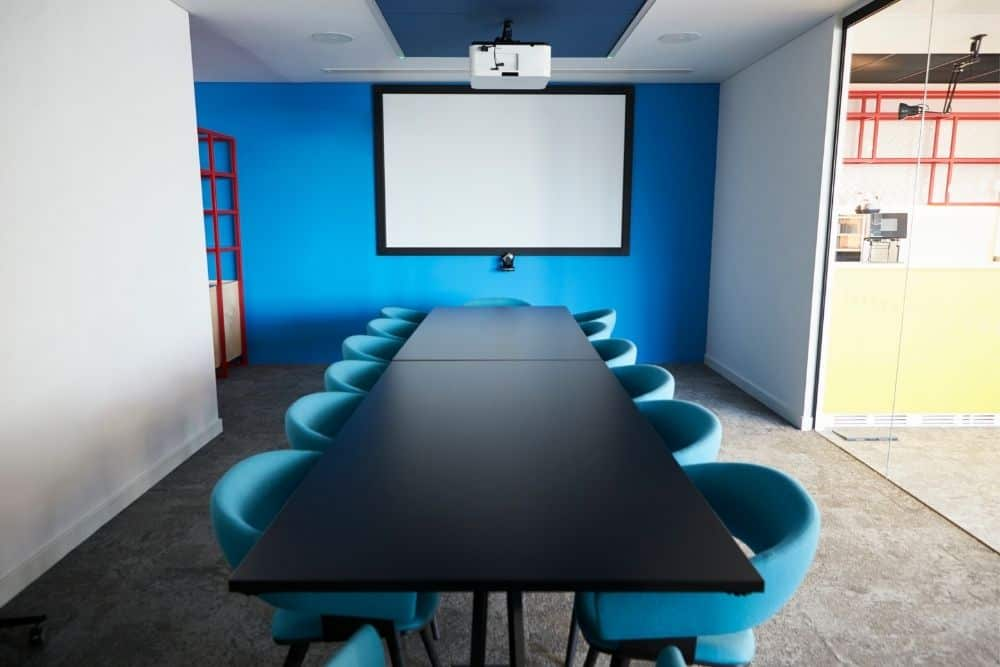 conference room with a mounted projector on ceiling