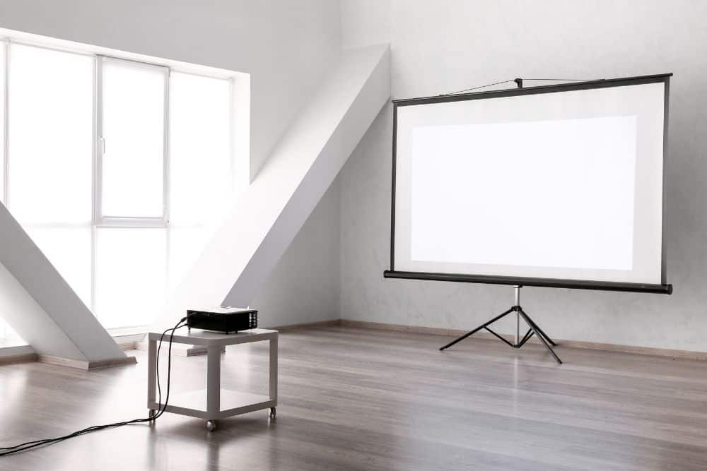 projector on a table with projector screen