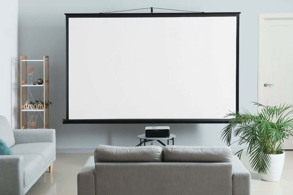 big projector screen with a projector in a room