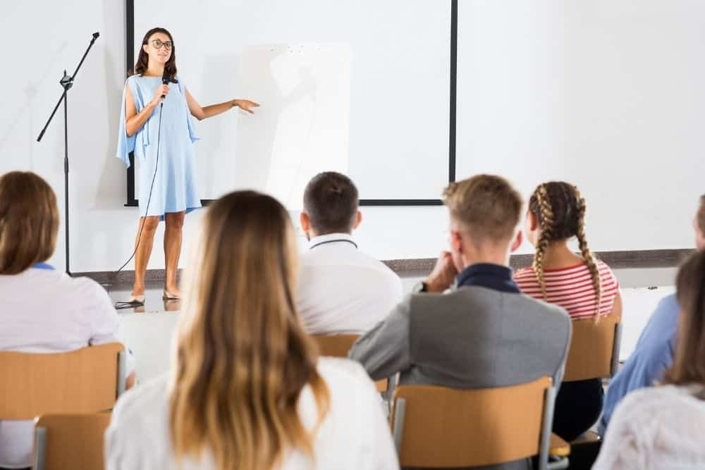 girl making a presentation in classroom