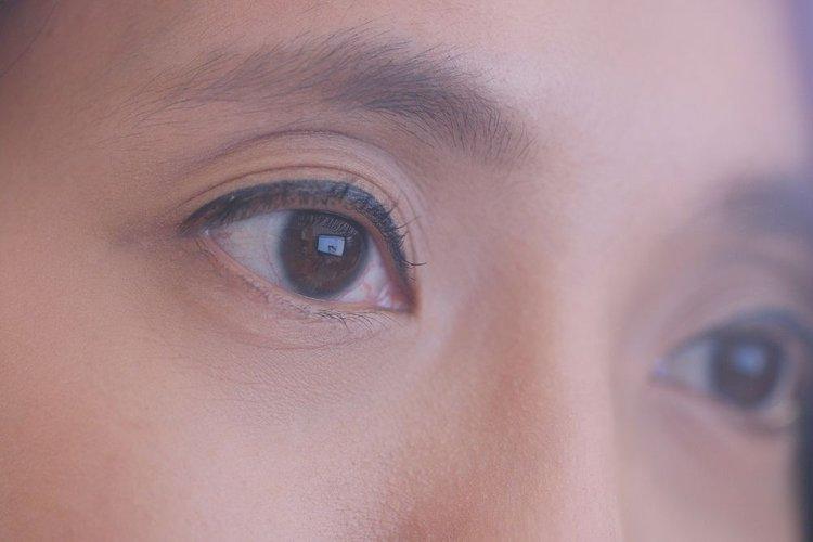 human eyes watching digital screens