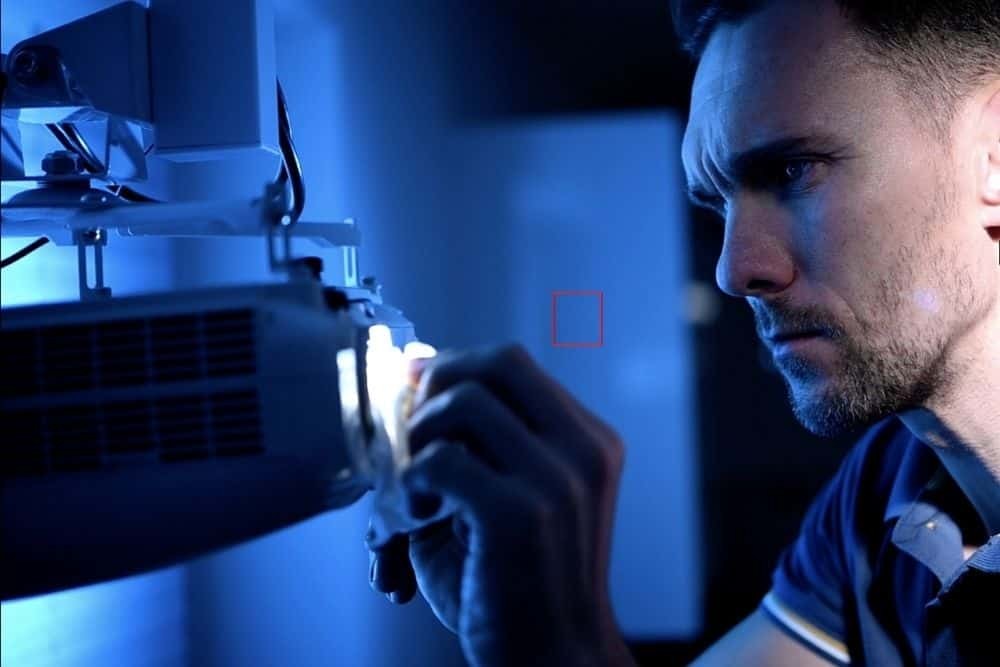 man installing a projector