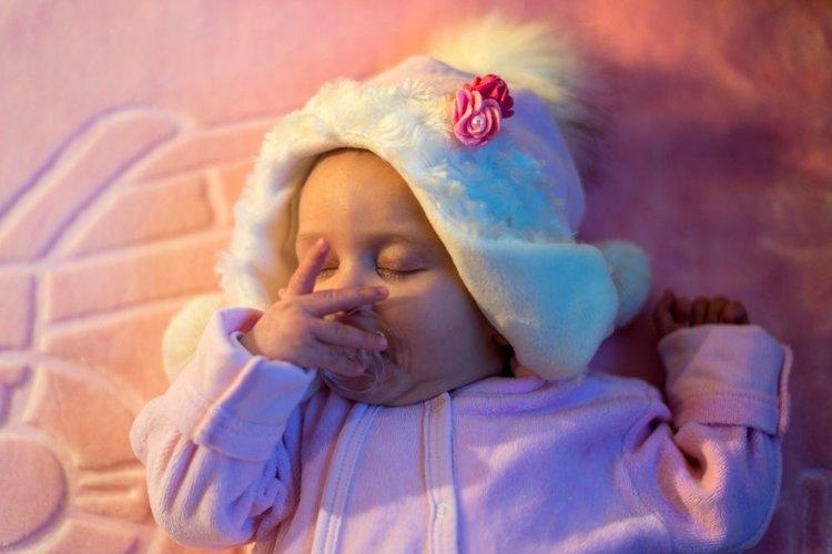 a baby sleeping in lighting