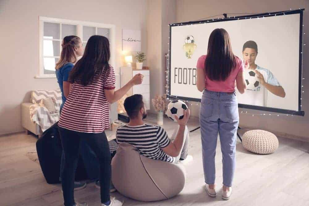 friends watching football on a high end projector screen