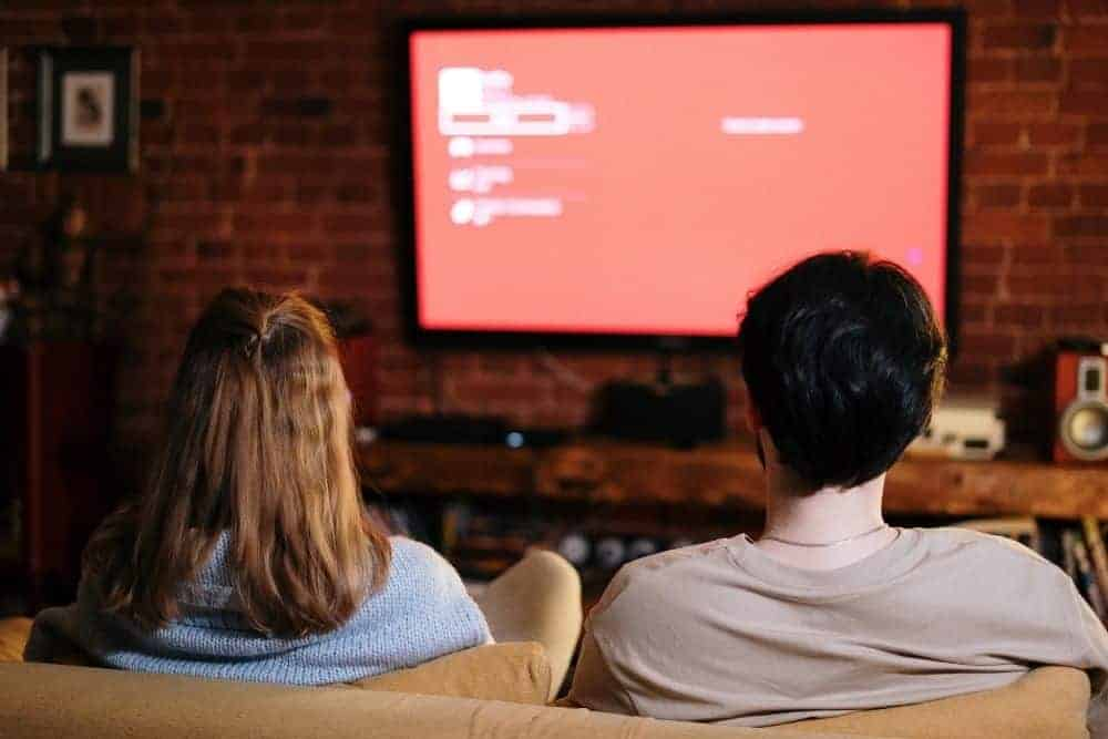 a couple watching movies on TV