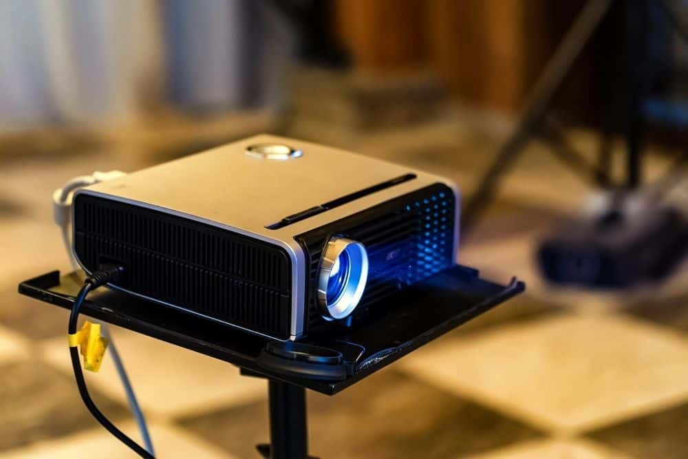 a small projector placed on projector stand