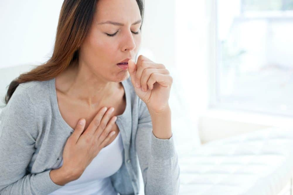a woman coughs due to inhaling mercury
