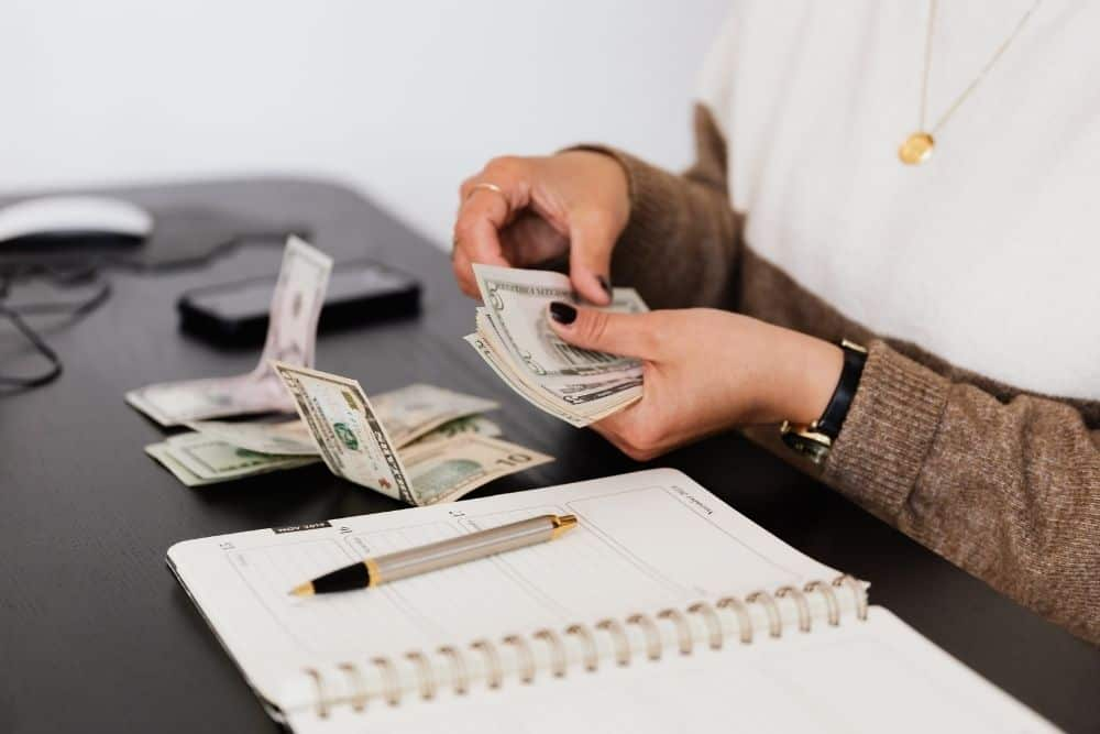 counting money for buying expensive passive soundbar