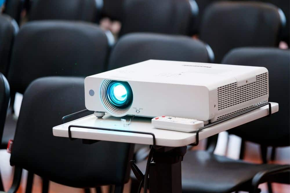 projector on a projector stand consuming power
