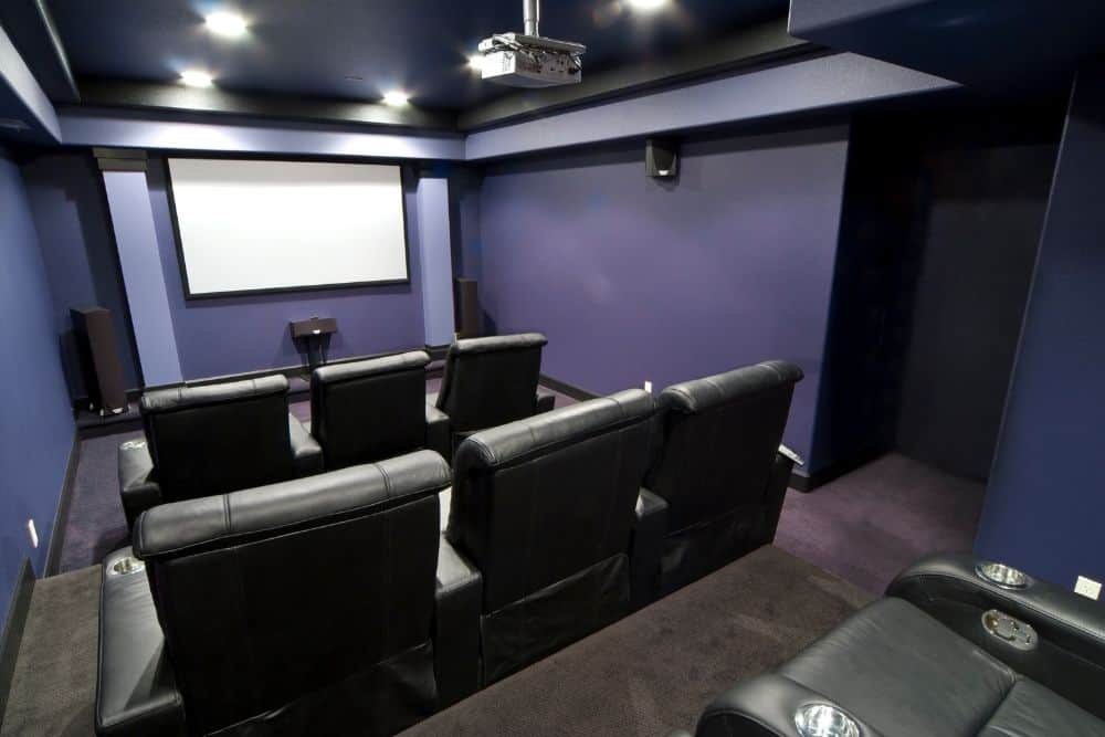stereo vs surround sound system on a theater room with projector and screen