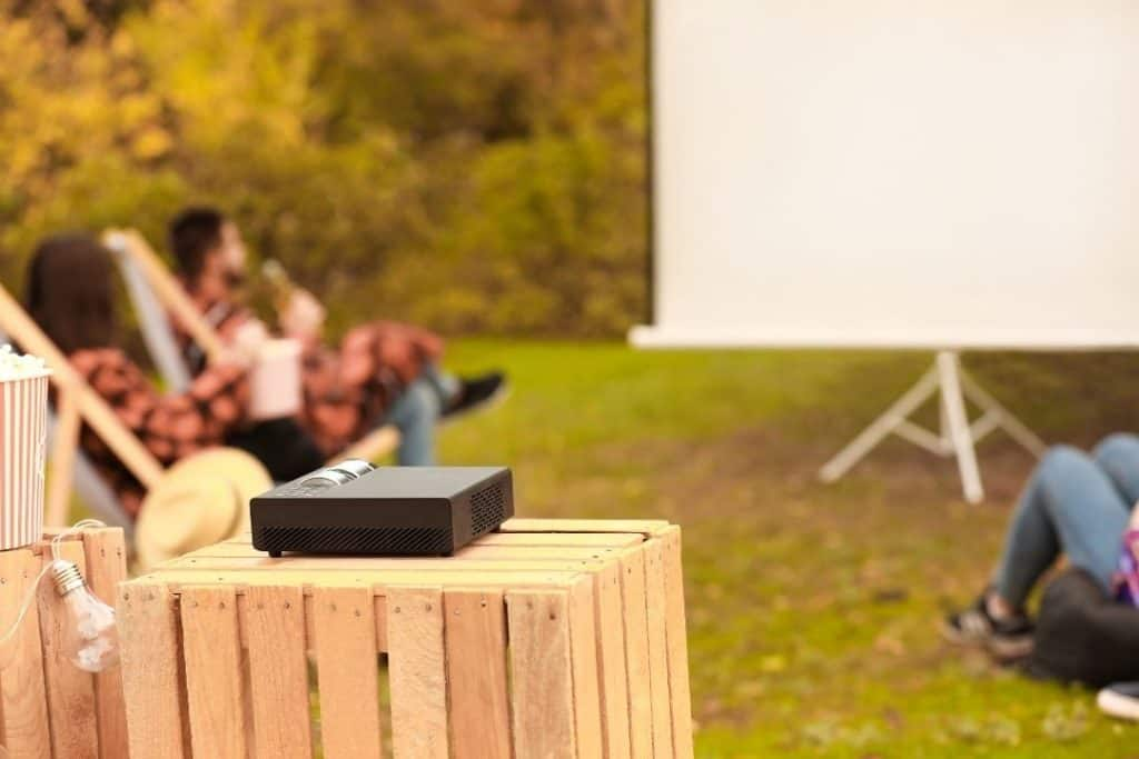 a outdoor projector placed in a wooden table