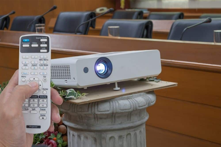 a man calibrate projector using a remote