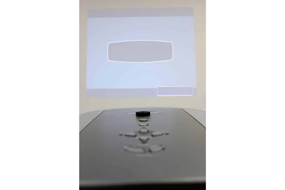 a projector throws image on the wall