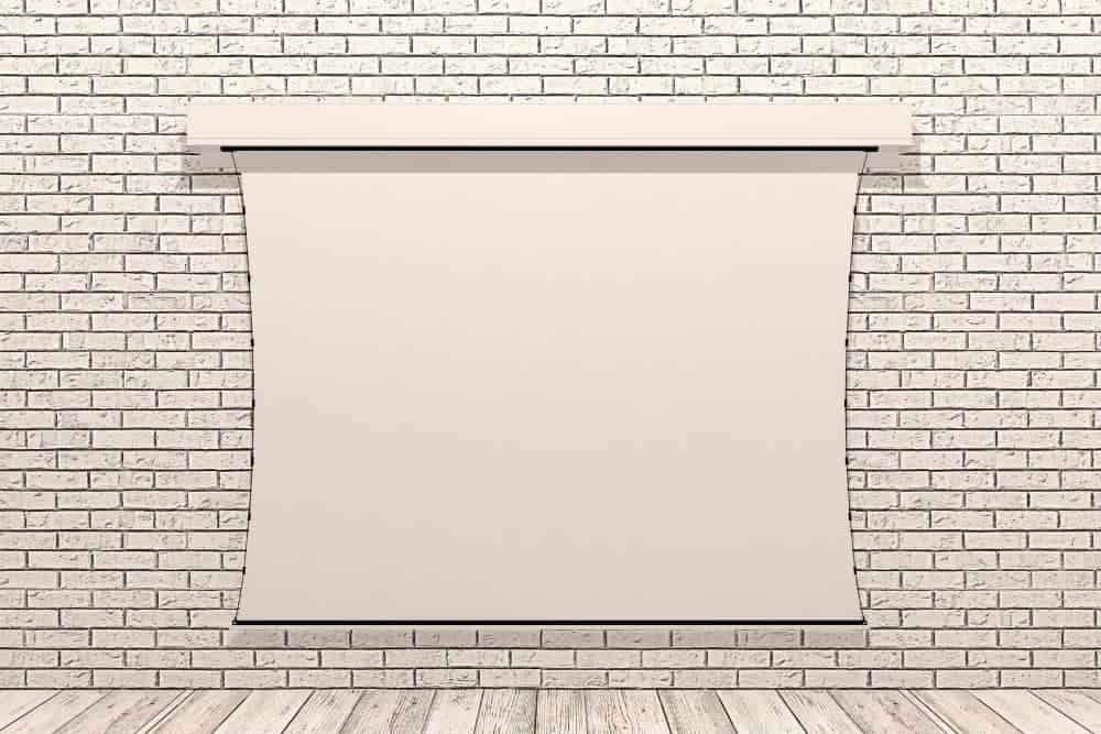 projector screen attached in a brick wall -min