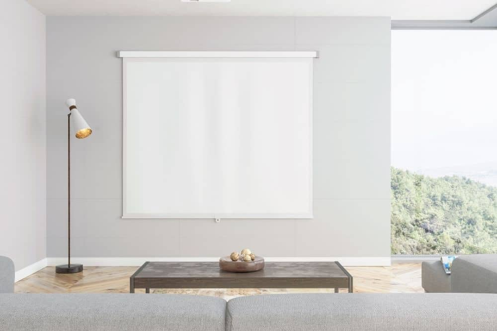 a clean room with projector screen installed on the wall