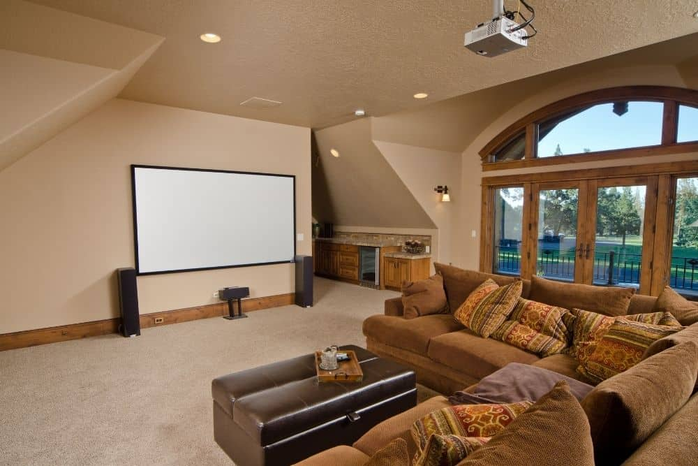 a cozy home theater with average screen